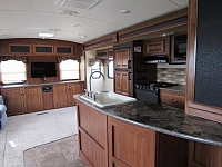 Used 2014 Cougar Lite Travel Trailer 32RET With Rear Entertainment